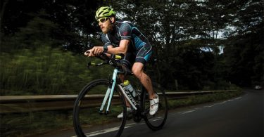 James Lawrence riding in a triathlon
