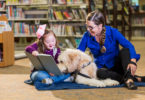 Paws to Read, a reading assistance program offered at libraries around the Peninsula, allows children ranging from just a few years old to the early teens to read to dogs to enhance their skills.